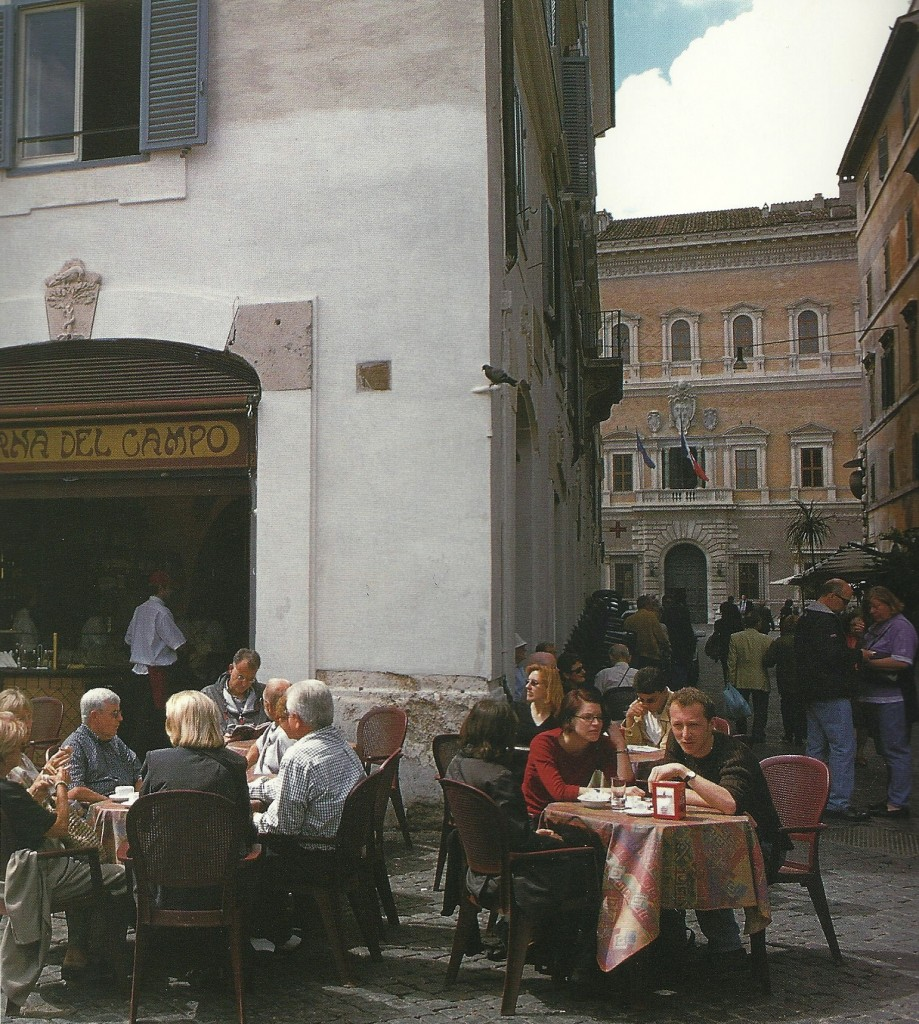 Rome, Campo dei Fiori, tables outside winebar, Piazza and Palazzo Farnese in the background, from Roma, by Julia della Croce Photo: Paolo Destefanis