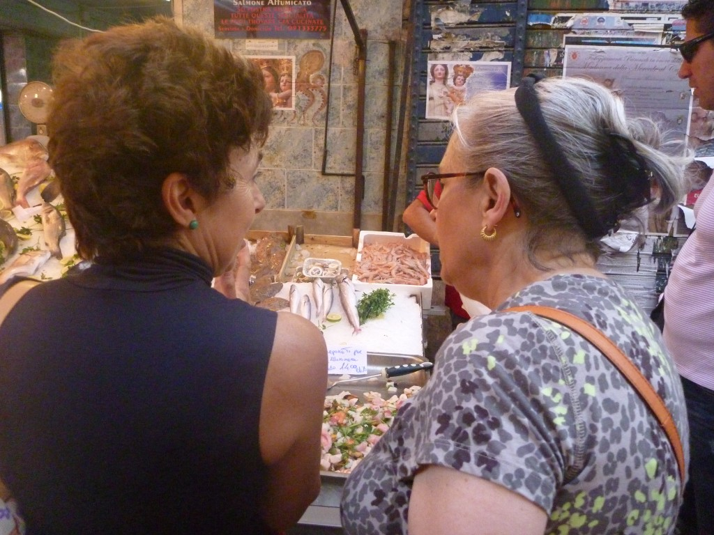 The Duchess at market with a student, explaining unfamiliar sea creatures.  Photo: Julia della Croce