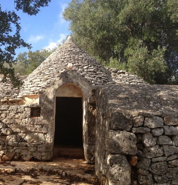 Trulli, Puglia's iconic, ancient drywall huts.  Photo: Nancy Harmon Jenkins, http://nancyharmonjenkins.com/posts/amorolio-is-rolling-on/