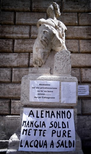 Pasquino today, collecting protests over the mayor's plans to privatize water. | Credit: Anthony Di Renzo