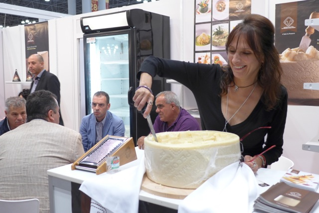 Exhibitor flaking off pieces or Pecorino Romano for tasting.