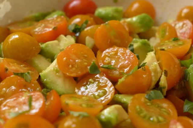 Toss the cut-up or diced tomatoes with the avocado and other ingredients.