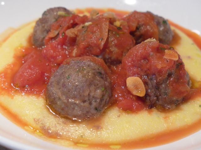 Meatballs over polenta. Can't get much more Italian than that.