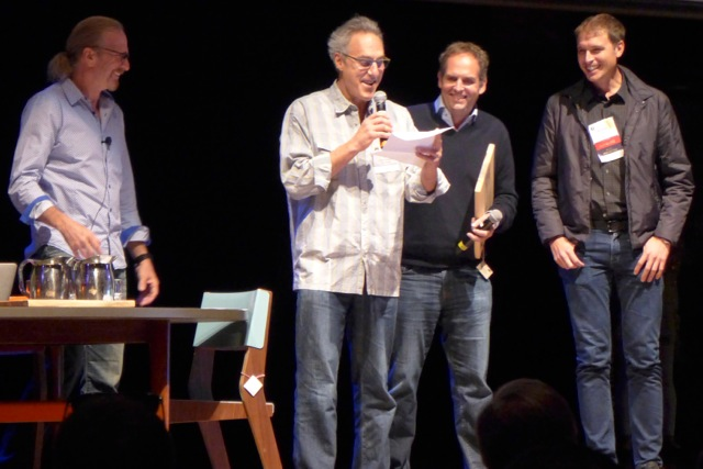 Woody Tasch (chairman/founder, Slow Money) giving Rocky Mountain Sustainer Award award to Hugo Mathieson and Kimbal Musk (The Kitchen, Boulder); Michel Nischan at left.