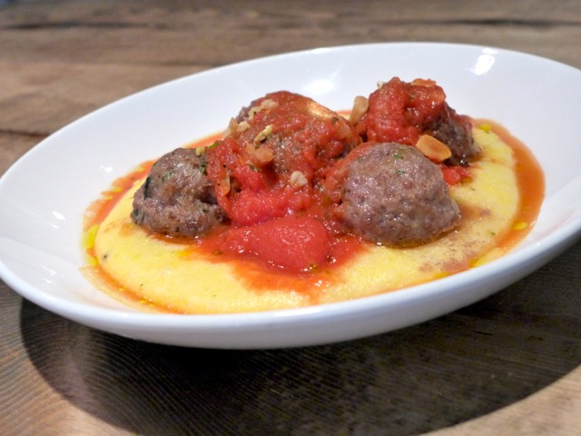 Loose polenta is a bed for meatballs at The Kitchen Next Door, Boulder. | Credit: Nathan Hoyt