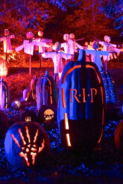 Colorful graveyard. In American Halloween lore, jack-o'-lantern represent the souls of the dead.