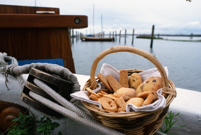 "A basket of traditional Venetian biscotti greet guests on the Eolo. | Photo: Copyright Paolo Destefanis for ""Veneto: Authentic Recipes From Venice and the Italian Northeast,"" by Julia della Croce (Chronicle Books)."