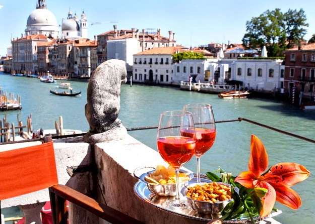 An aperitivo on the balcony of a doge's palace. | Photo by Paolo Destefanis for Veneto: Authentic Recipes From Venice and the Italian Northeast, by Julia della Croce
